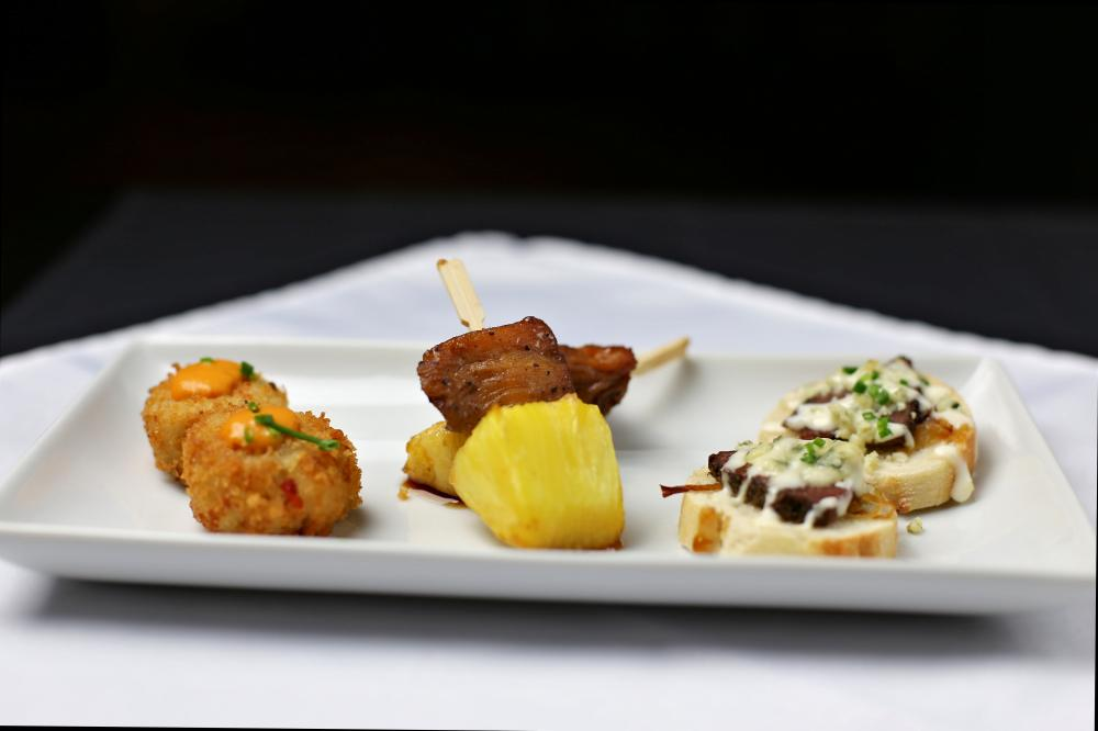 -Mini Blue Crab Cake, w/ Tomato-Dijon Coulis -Jerk Chicken Skewer w/ Rum-Glazed Pineapple -Beef Tenderloin Crostini, w/ Gorgonzola, Caramelized Onion & Roasted Garlic Aioli