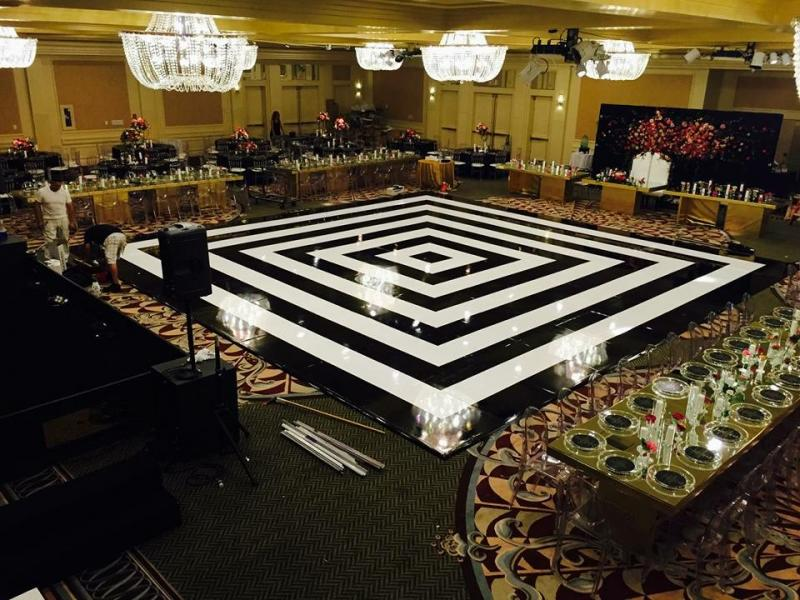 Seamless black and white dance floor with ghost chairs