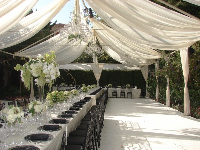 Black and White wedding reception with tent draping