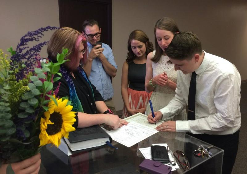 Ancia Mann and Heather Ginder sign their wedding license following the ceremony at the courthouse on Oct. 6, 2014.