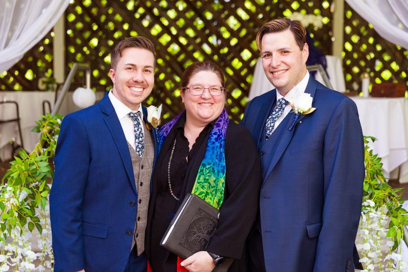 Tyson and Jared pose with Rev. Heron following their June 2018 wedding in Midvale, Utah.
