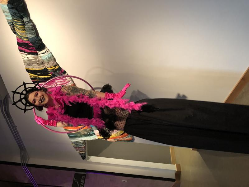 Stilt walkers with a variety of outfits