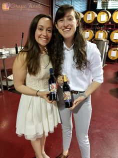 Kate and Lily with the wine wedding favors their shower guests helped them create.