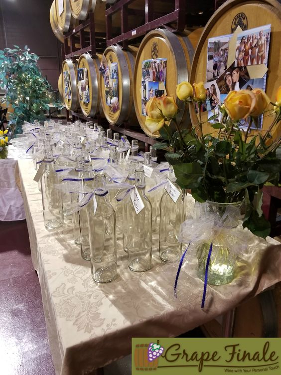 Empty wine bottles ready for each guest to fill and take home as a favor.