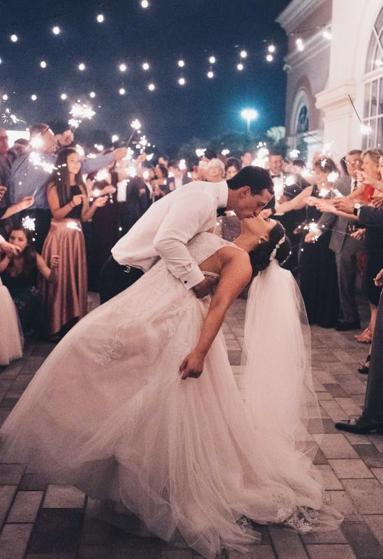 Midnight kiss under Thomas Edison lighting on our